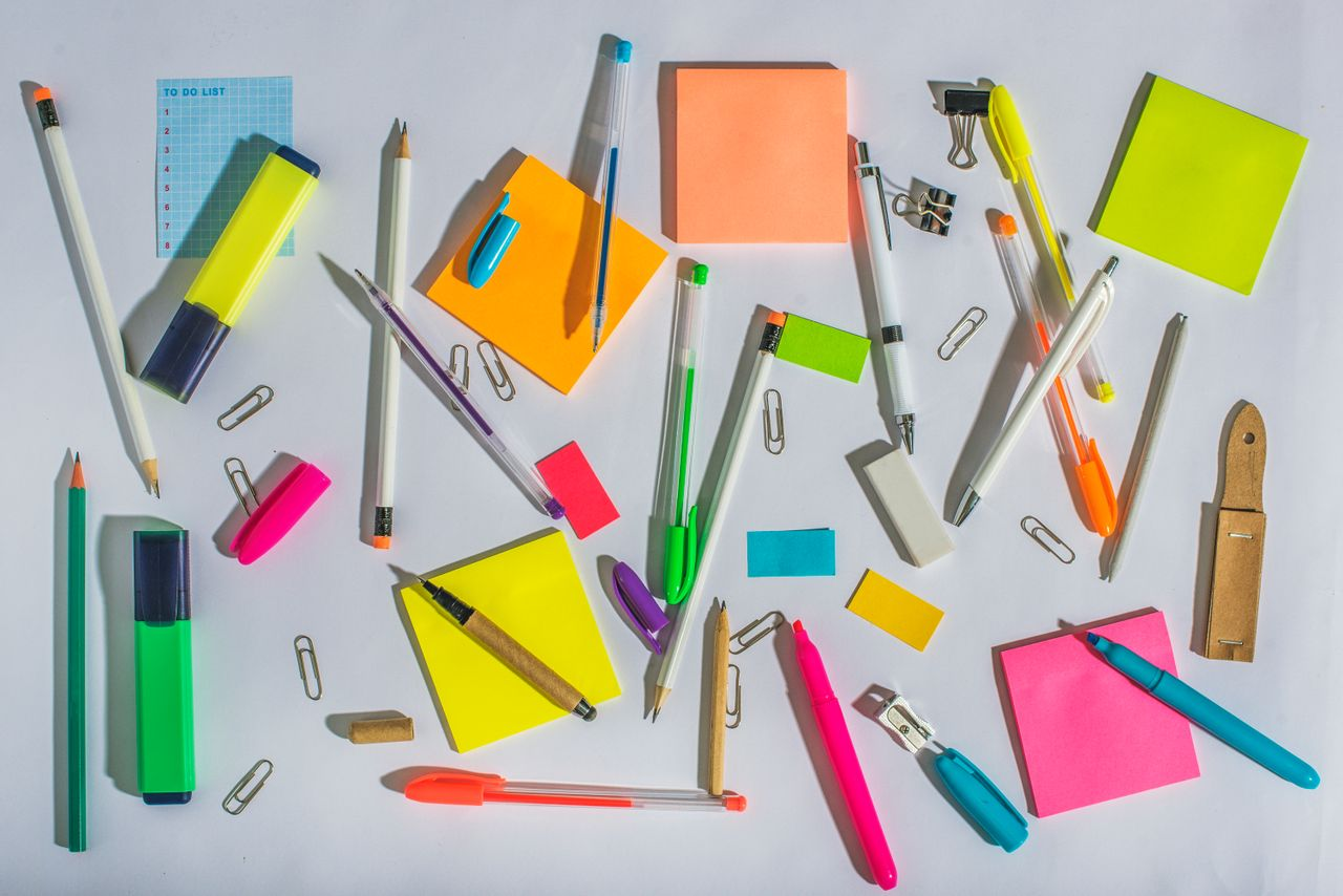Photo array of messy office supplies