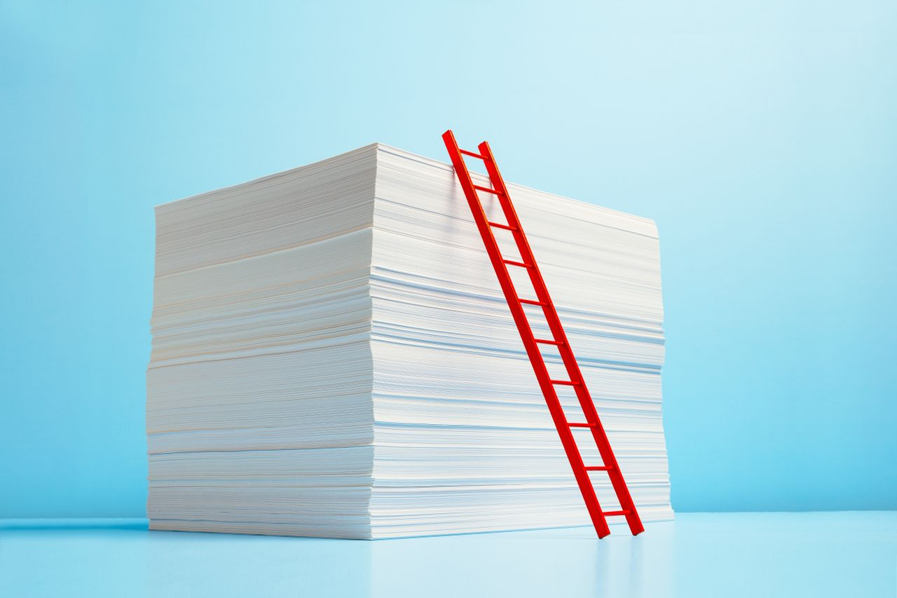 Stack of papers with a ladder