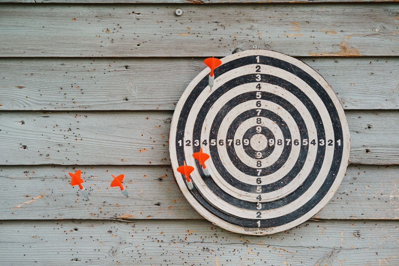 Dart board with darts off target