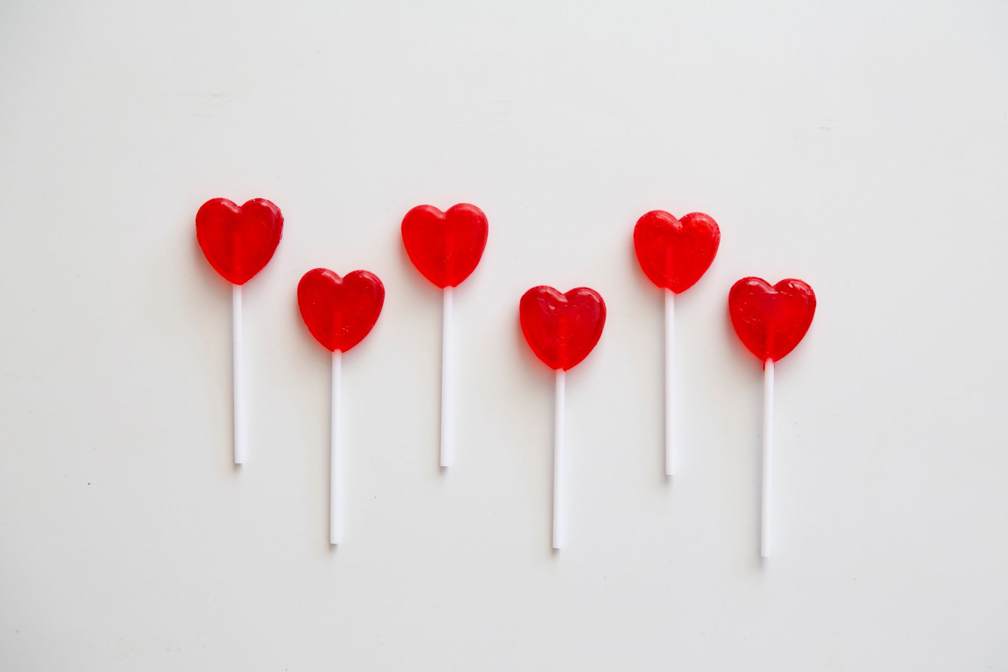Heart shaped lollipops in a row