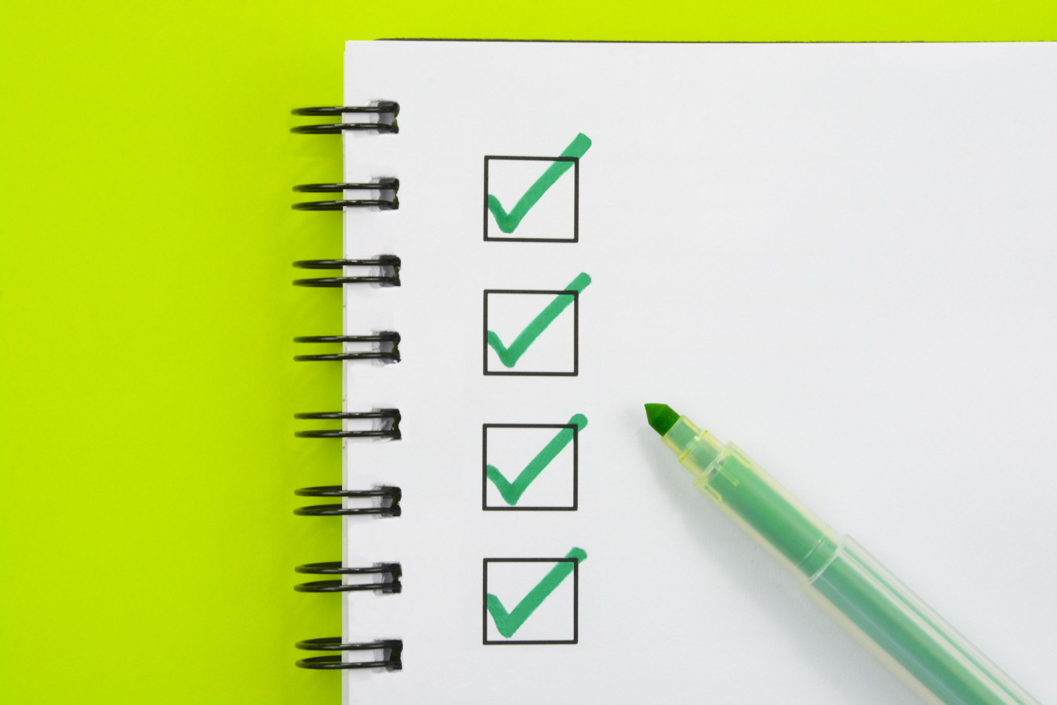 Notebook with checklist in green marker