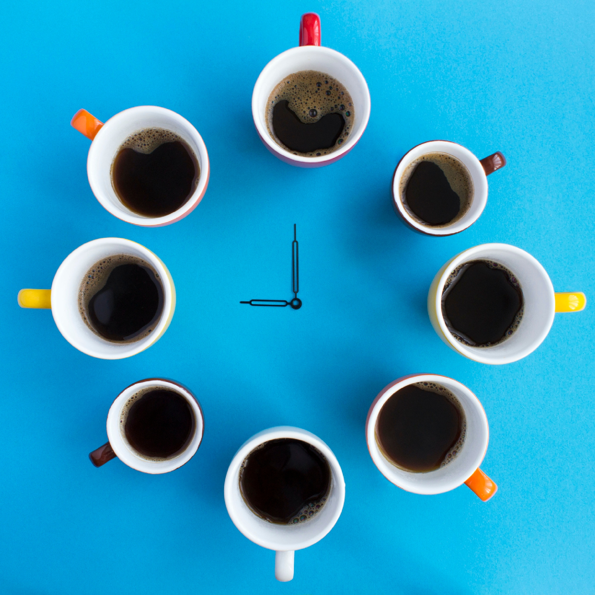Photo of cups of coffee forming a clock