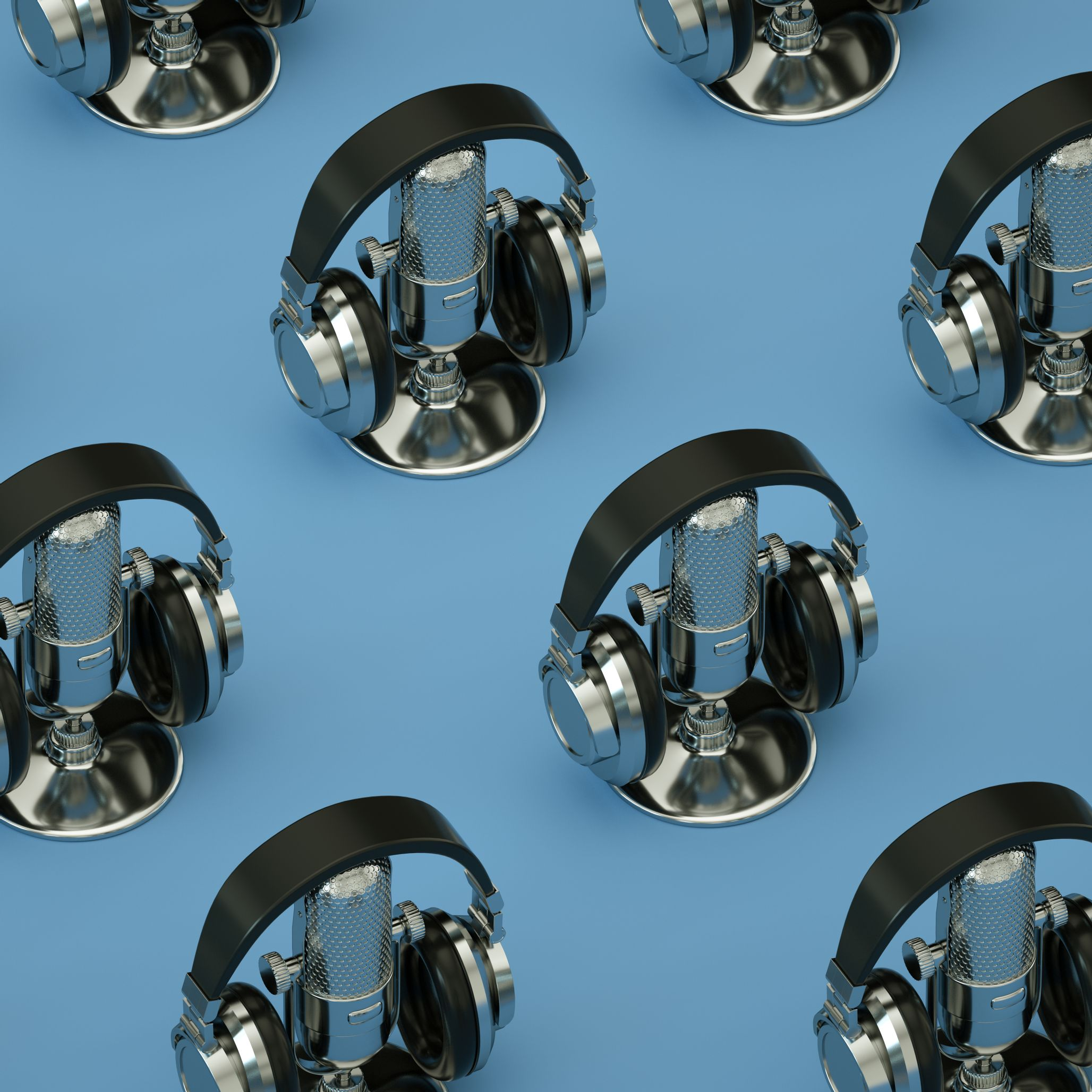 Photo of repeating headphones and podcast microphone