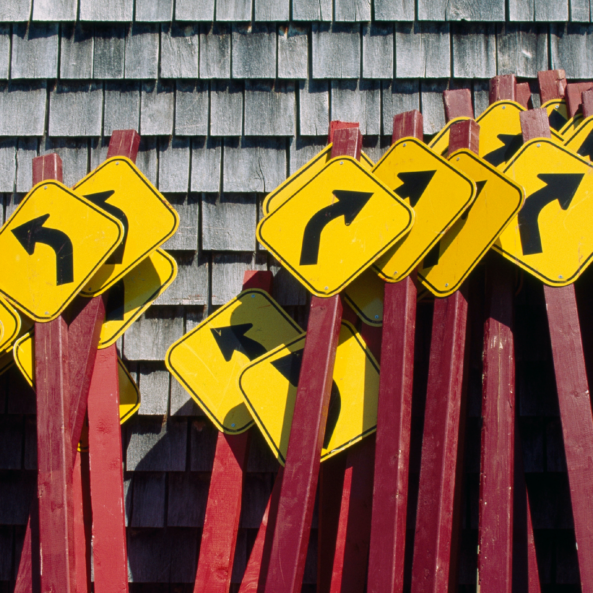 Photo of street signs with arrows pointing in different directions