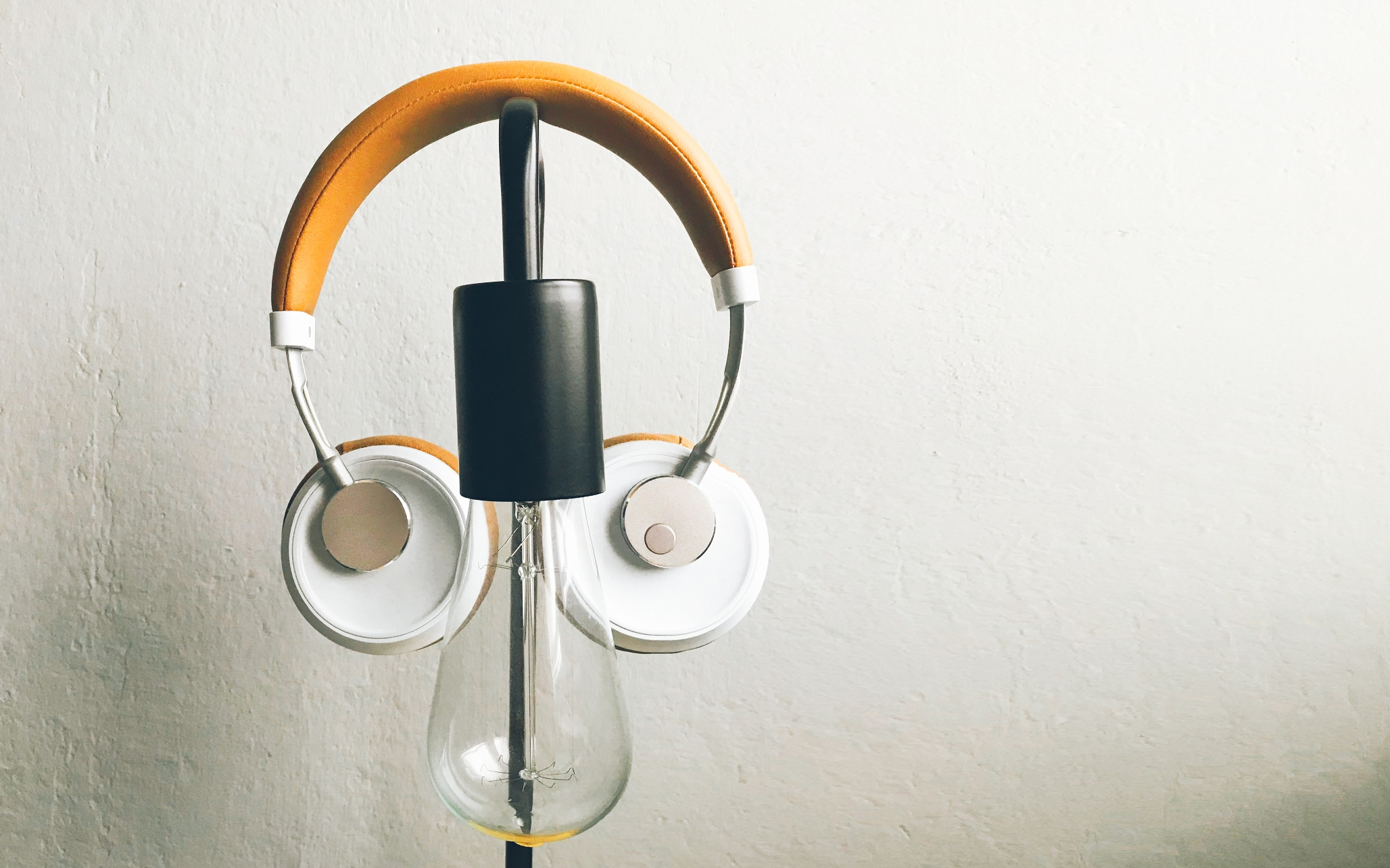 Photo of light bulb and headphones