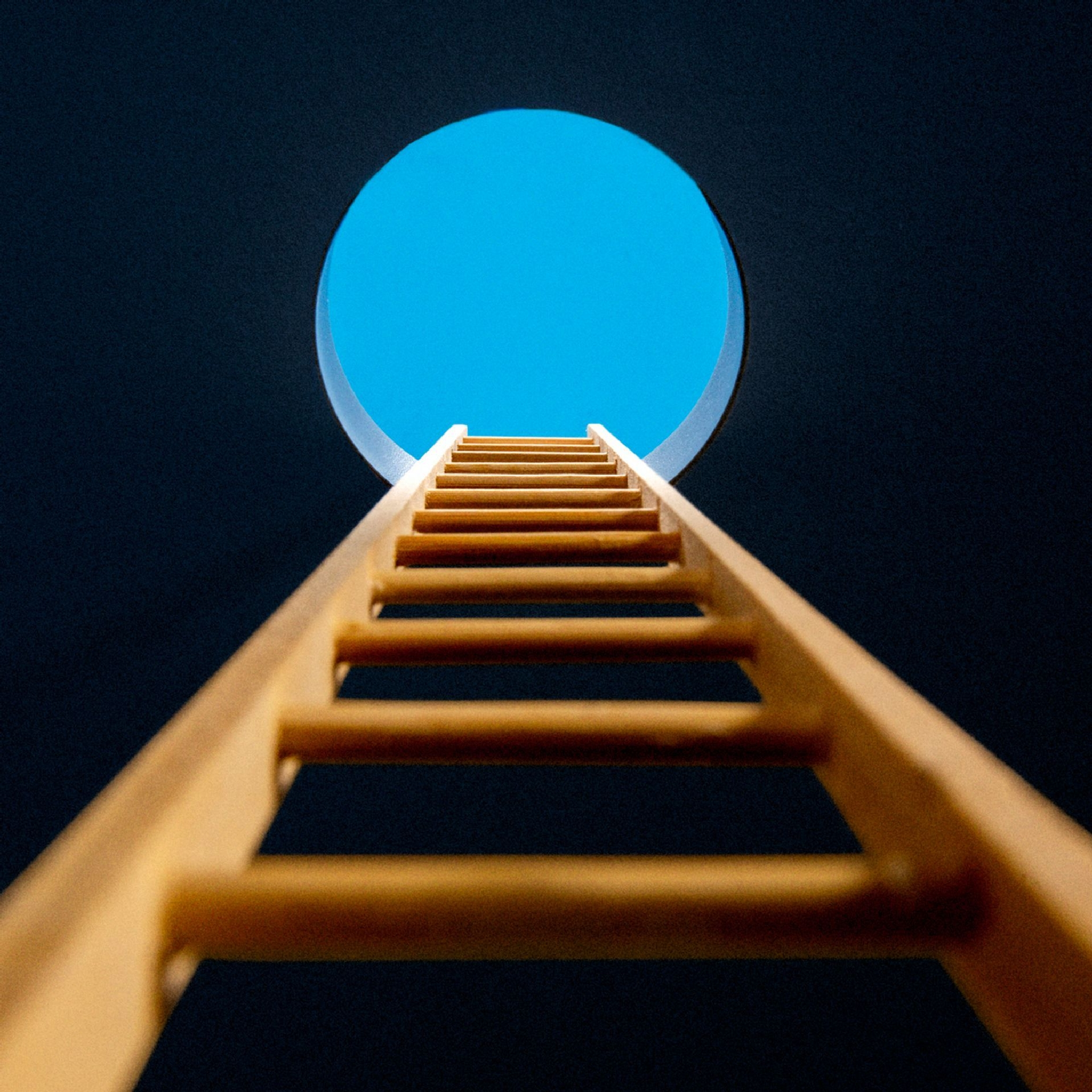 A ladder leading to an open sky